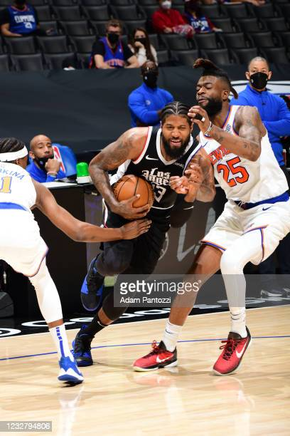 Paul George of the LA Clippers dribbles the ball during the game against the New York Knicks on May 9, 2021 at STAPLES Center in Los Angeles,...