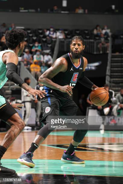 Paul George of the LA Clippers dribbles the ball during the game against the Charlotte Hornets on May 13, 2021 at Spectrum Center in Charlotte, North...