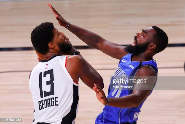 Paul George of the LA Clippers drives against Tim Hardaway Jr. #11 of the Dallas Mavericks during the second quarter in Game Three of the Western...