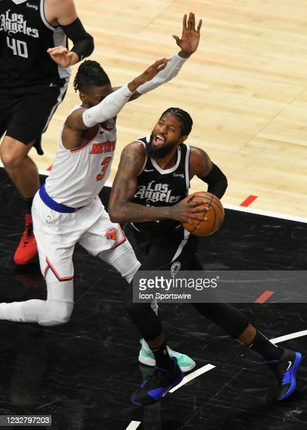 Paul George of the LA Clippers drives into Nerlens Noel of the New York Knicks in the first half during the Los Angeles Clippers versus New York...