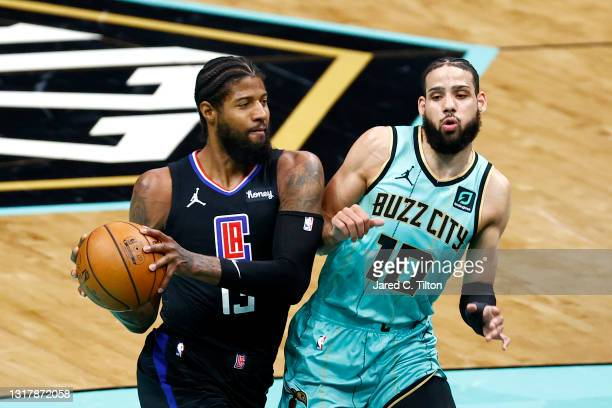 Paul George of the LA Clippers drives to the basket against Caleb Martin of the Charlotte Hornets during the second quarter of their game at Spectrum...