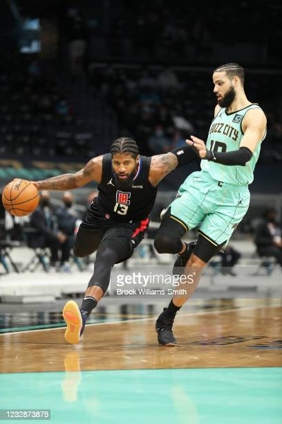 Paul George of the LA Clippers drives to the basket against the Charlotte Hornets on May 13, 2021 at Spectrum Center in Charlotte, North Carolina....