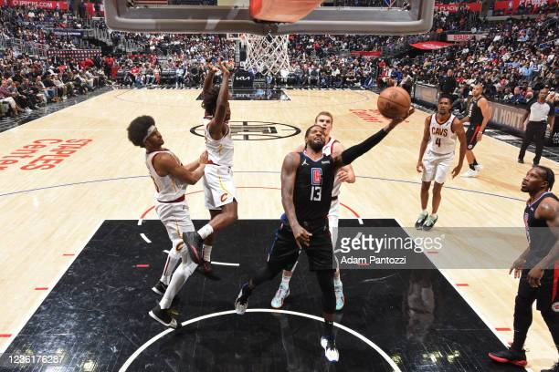 Paul George of the LA Clippers drives to the basket against the Cleveland Cavaliers on October 27, 2021 at STAPLES Center in Los Angeles, California....