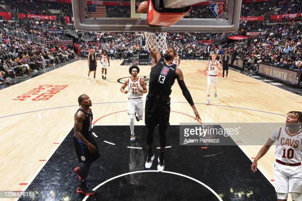 Paul George of the LA Clippers dunks the ball against the Cleveland Cavaliers on October 27, 2021 at STAPLES Center in Los Angeles, California. NOTE...