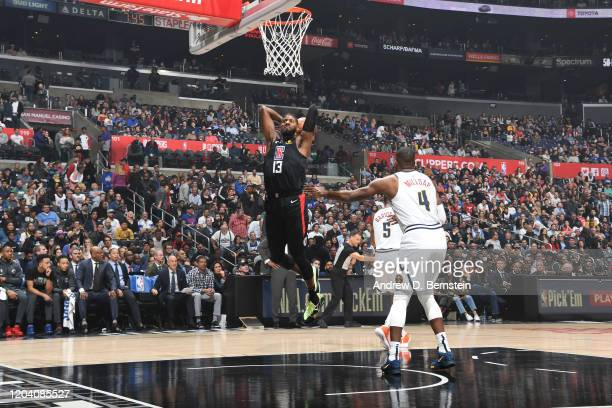 Paul George of the LA Clippers dunks the ball against the Denver Nuggets on February 28 2020 at STAPLES Center in Los Angeles California NOTE TO USER...