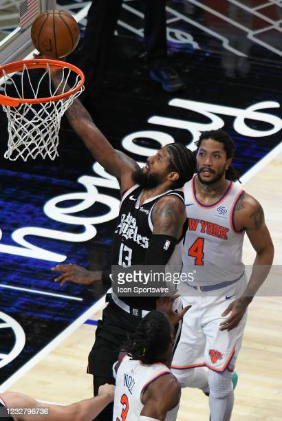 Paul George of the LA Clippers gets past Derrick Rose of the New York Knicks in the first half during the Los Angeles Clippers versus New York Knicks...