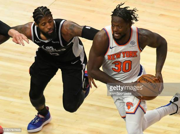 Paul George of the LA Clippers guards Julius Randle of the New York Knicks in the second half during the Los Angeles Clippers versus New York Knicks...