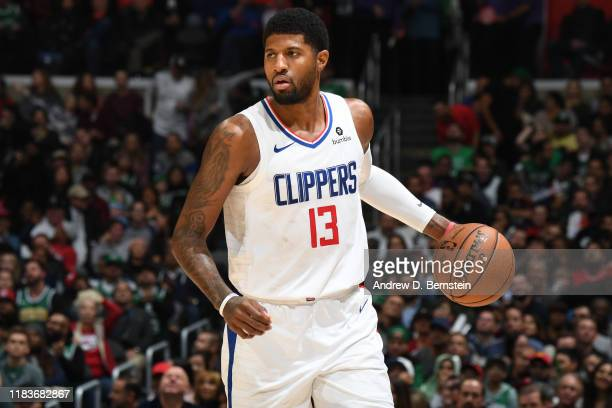 Paul George of the LA Clippers handles the ball against the Boston Celtics on November 20, 2019 at STAPLES Center in Los Angeles, California. NOTE TO...