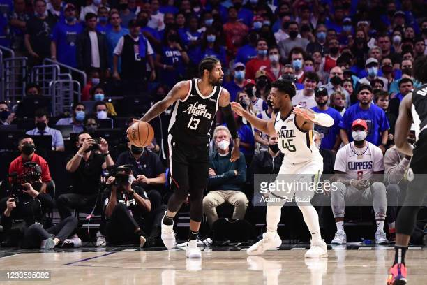 Paul George of the LA Clippers handles the ball as Donovan Mitchell of the Utah Jazz plays defense during the game during Round 2, Game 6 of the 2021...