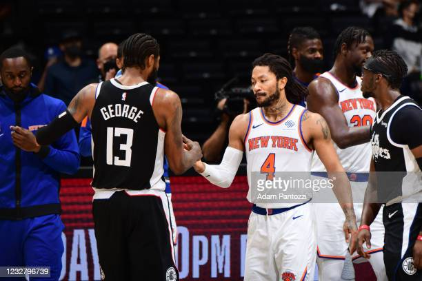 Paul George of the LA Clippers hi-fives Derrick Rose of the New York Knicks after the game on May 9, 2021 at STAPLES Center in Los Angeles,...