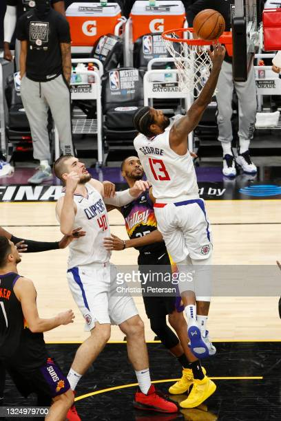 Paul George of the LA Clippers makes a lay up in the final minutes of the fourth quarter in game two of the NBA Western Conference finals against the...
