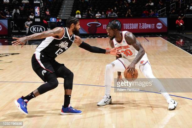 Paul George of the LA Clippers plays defense on Julius Randle of the New York Knicks during the game on May 9, 2021 at STAPLES Center in Los Angeles,...