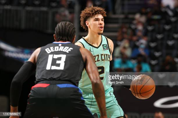 Paul George of the LA Clippers plays defense on LaMelo Ball of the Charlotte Hornets on May 13, 2021 at Spectrum Center in Charlotte, North Carolina....