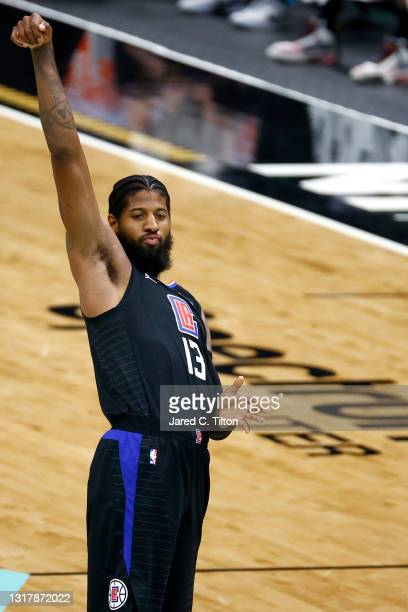 Paul George of the LA Clippers reacts following a three point basket attempt during the second quarter of their game against the Charlotte Hornets at...