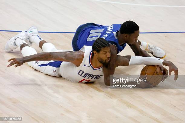 Paul George of the LA Clippers scrambles for the ball against Dorian Finney-Smith of the Dallas Mavericks in the second quarter during Game Six of...