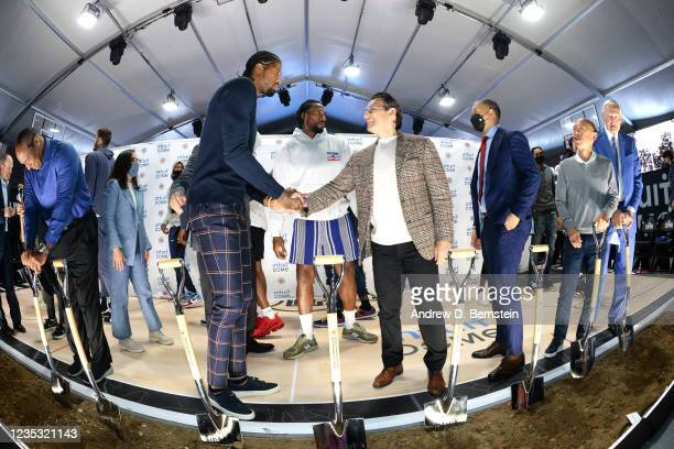 Paul George of the LA Clippers shakes hands with CEO of Intuit Sasan K. Goodarzi during the LA Clippers ground breaking on Intuit Dome on September...