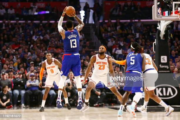 Paul George of the LA Clippers shoots a three point basket against the New York Knicks on January 5 2020 at STAPLES Center in Los Angeles California...
