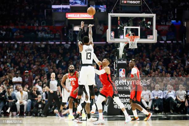 Paul George of the LA Clippers shoots a three point basket during the game against the Houston Rockets on December 19 2019 at STAPLES Center in Los...