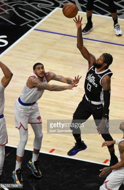 Paul George of the LA Clippers shoots over Obi Toppin of the New York Knicks in the first half during the Los Angeles Clippers versus New York Knicks...