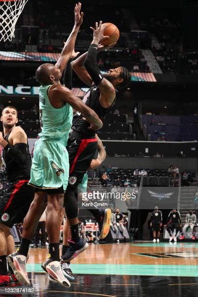 Paul George of the LA Clippers shoots the ball during the game against the Charlotte Hornets on May 13, 2021 at Spectrum Center in Charlotte, North...