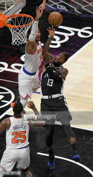 Paul George of the LA Clippers shoots the ball over Derrick Rose of the New York Knicks in the first half during the Los Angeles Clippers versus New...