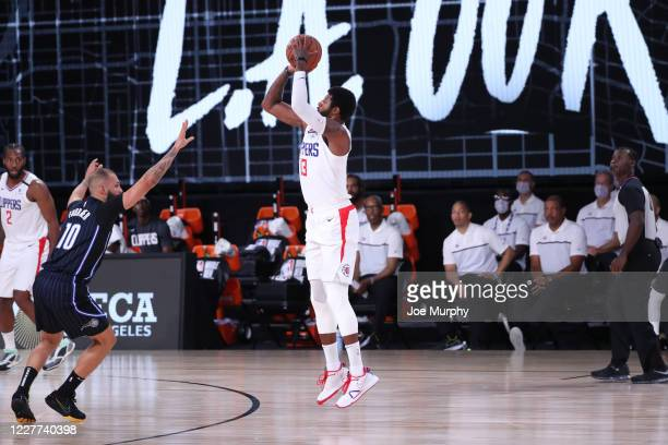 Paul George of the LA Clippers shoots three point basket against the Orlando Magic on July 22 2020 at The Arena at ESPN Wide World of Sports Complex...