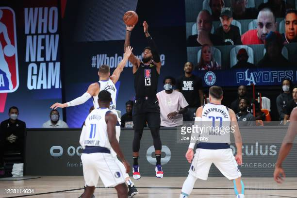 Paul George of the LA Clippers shoots three point basket against the Dallas Mavericks during Round One, Game Two of the NBA Playoffs on August 19,...