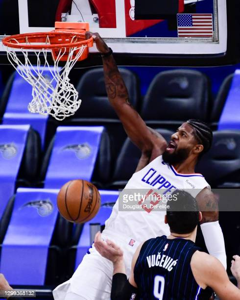 Paul George of the LA Clippers slams the ball during the first quarter against the Orlando Magic at Amway Center on January 29, 2021 in Orlando,...