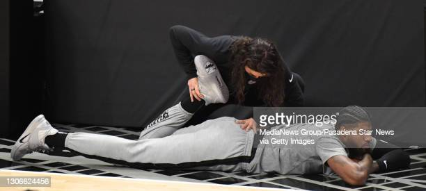 Paul George of the LA Clippers stretches prior to a NBA basketball game against the Golden State Warriors at the Staples Center in Los Angeles on...