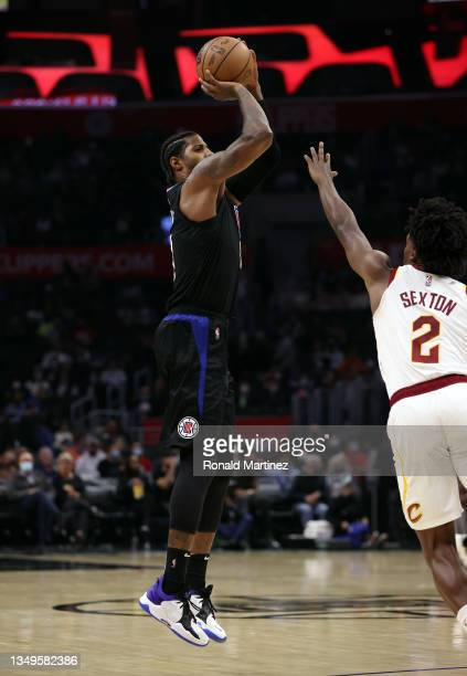 Paul George of the LA Clippers takes a shot against Collin Sexton of the Cleveland Cavaliers in the fourth quarter at Staples Center on October 27,...