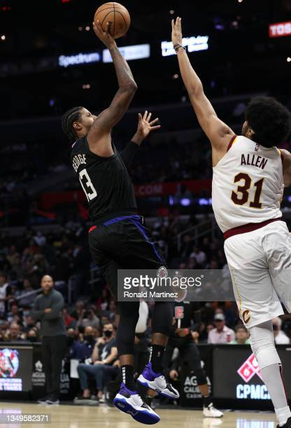 Paul George of the LA Clippers takes a shot against Jarrett Allen of the Cleveland Cavaliers in the fourth quarter at Staples Center on October 27,...