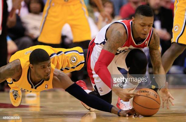 Paul George of the Indiana Pacers and Bradley Beal of the Washington Wizards go after a loose ball during the first half of Game 3 of the Eastern...
