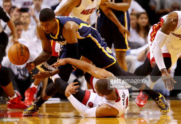 Paul George of the Indiana Pacers and Dwyane Wade of the Miami Heat battle for a loose ball during Game Four of the Eastern Conference Finals of the...