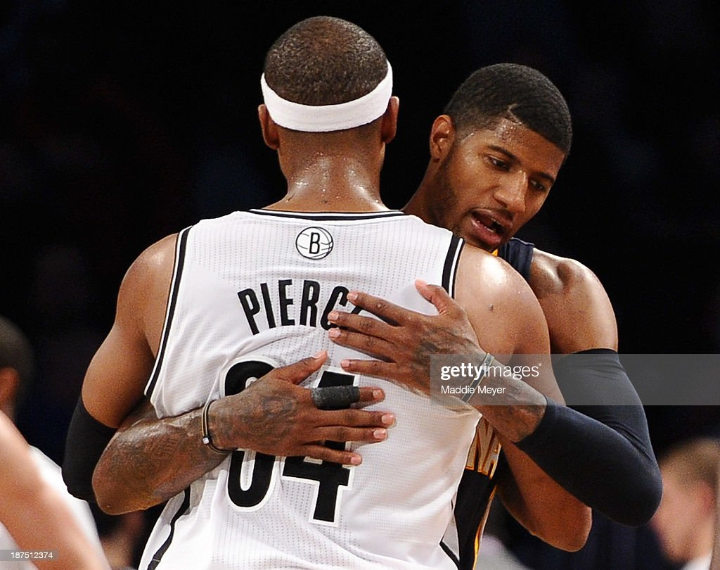 Paul George #24 of the Indiana Pacers and Paul Pierce #34 of the Brooklyn Nets embrace after their game at Barclays Center on November 9, 2013 in the Brooklyn borough of New York City. The Pacers defeat the Nets 96-91.