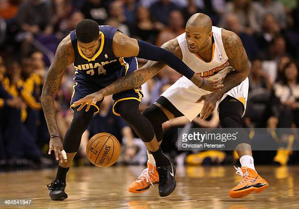 Paul George of the Indiana Pacers and PJ Tucker of the Phoenix Suns battle for a loose ball during the second half of the NBA game at US Airways...
