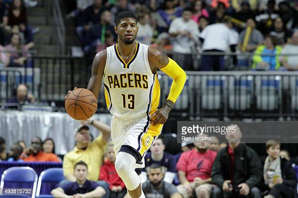 Paul George of the Indiana Pacers brings the ball up court against the Charlotte Hornets on October 22 2015 at Allen County War Memorial Coliseum in...