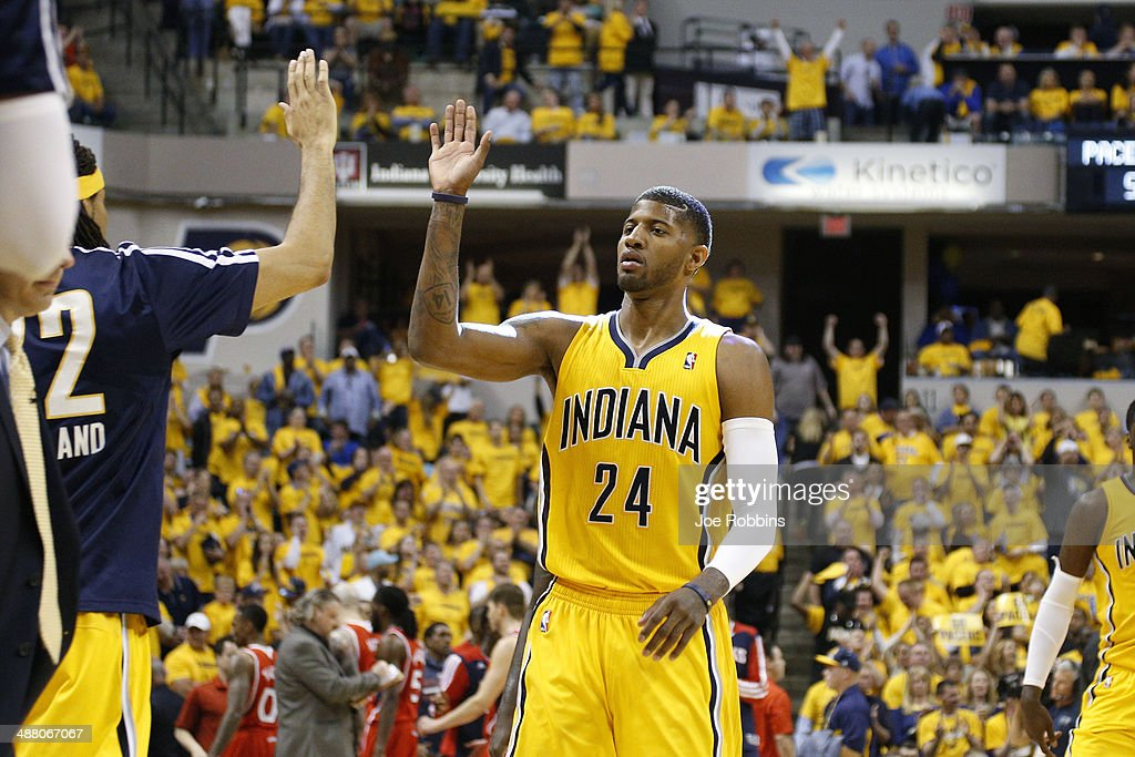 Paul George #24 of the Indiana Pacers celebrates as he walks to the bench during a timeout against the Atlanta Hawks during Game Seven of the Eastern Conference Quarterfinals of the 2014 NBA Playoffs on May 3, 2014 at Bankers Life Fieldhouse in Indianapolis, Indiana. The Pacers won 92-80.
