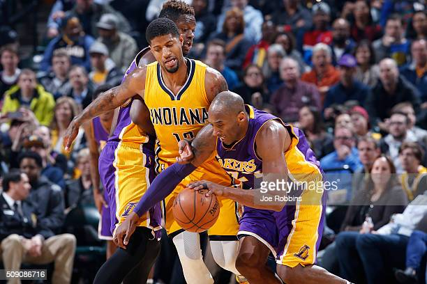 Paul George of the Indiana Pacers defends against Kobe Bryant of the Los Angeles Lakers in the first half of the game at Bankers Life Fieldhouse on...