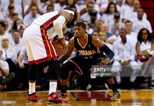 Paul George of the Indiana Pacers defends against LeBron James of the Miami Heat during Game Four of the Eastern Conference Finals of the 2014 NBA...