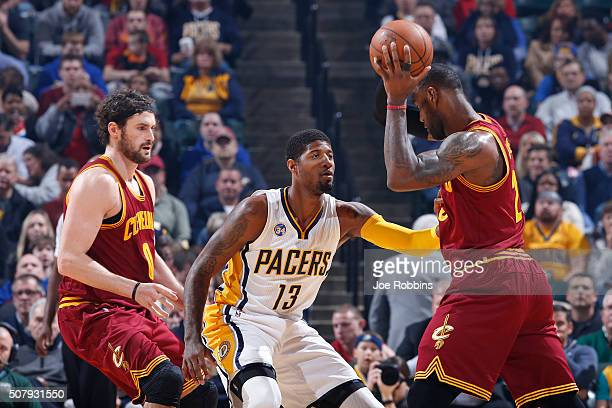 Paul George of the Indiana Pacers defends against LeBron James of the Cleveland Cavaliers in the first half of the game at Bankers Life Fieldhouse on...