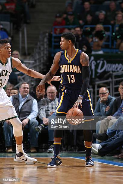44bc564ee9bc Paul George of the Indiana Pacers defends the ball against the Milwaukee  Bucks during the game