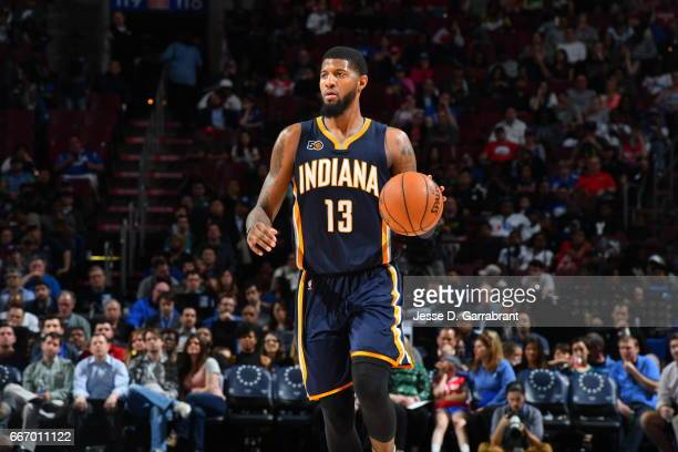 Paul George of the Indiana Pacers dribbles the ball against the Philadelphia 76ers at Wells Fargo Center on April 10 2017 in Philadelphia...