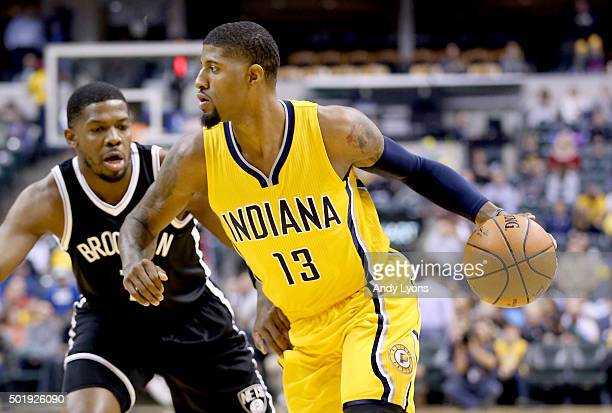 Paul George of the Indiana Pacers dribbles the ball against the Brooklyn Nets during the game at Bankers Life Fieldhouse on December 18 2015 in...