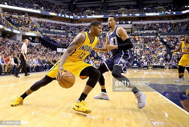 Paul George of the Indiana Pacers dribbles the ball during the game against the Oklahoma City Thunder at Bankers Life Fieldhouse on March 19 2016 in...