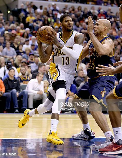 Paul George of the Indiana Pacers dribbles the ball during the game against the Cleveland Cavaliers at Bankers Life Fieldhouse on April 6 2016 in...