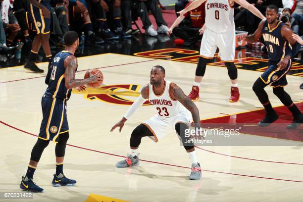 Paul George of the Indiana Pacers dribbles the ball while guarded by LeBron James of the Cleveland Cavaliers during Game Two the Eastern Conference...