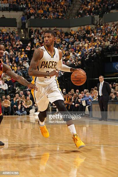 Paul George of the Indiana Pacers dribbles up the court against the Cleveland Cavaliers at Bankers Life Fieldhouse on December 28 2013 in...