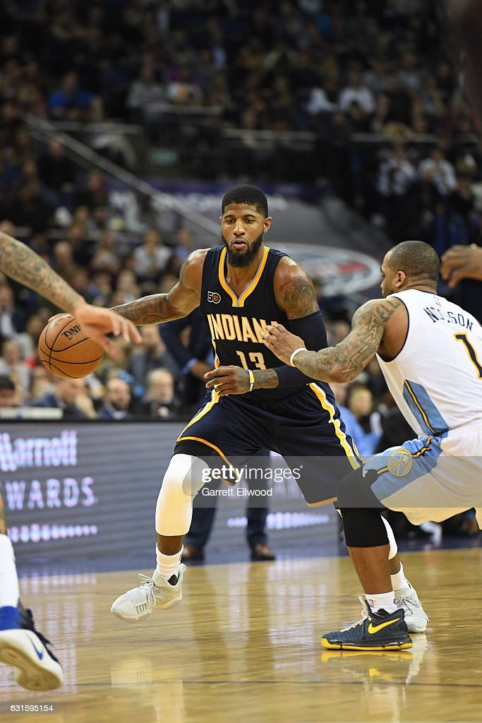 Paul George #13 of the Indiana Pacers drives against Jameer Nelson #1 of the Denver Nuggets as part of 2017 NBA London Global Games at the O2 Arena on January 12, 2017 in London, England.