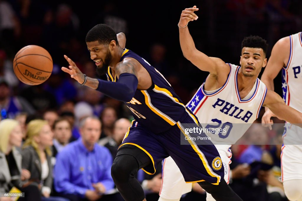 Paul George #13 of the Indiana Pacers drives down court after being fouled by Timothe Luwawu-Cabarrot #20 of the Philadelphia 76ers during the third quarter at the Wells Fargo Center on April 10, 2017 in Philadelphia, Pennsylvania. The Pacers won 120-111.