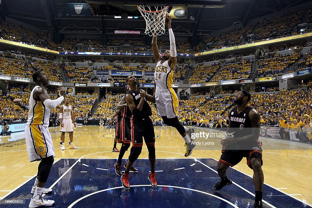 Paul George #24 of the Indiana Pacers drives for a dunk attempt against Chris Bosh #1 and LeBron James #6 of the Miami Heat during Game Four of the Eastern Conference Finals of the 2013 NBA Playoffs at Bankers Life Fieldhouse on May 28, 2013 in Indianapolis, Indiana.